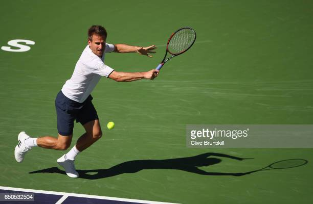 Peter Gojowczyk of Germany in action against Reilly Opelka of the United States in their first round match during day four of the BNP Paribas Open at...