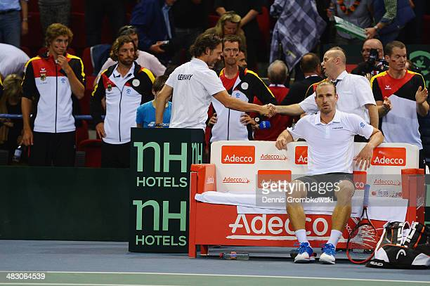 Peter Gojowczyk of Germany looks dejected after his defeat against Gael Monfils of France during day 3 of the Davis Cup Quarter Final match between...