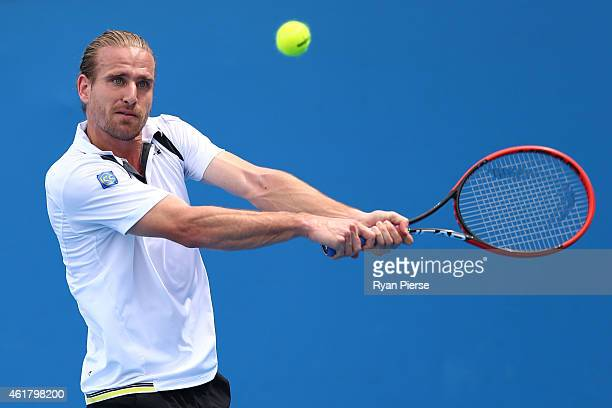 Peter Gojowczyk of Germany plays a backhand in his first round match against Guillermo GarciaLopez of Spain during day two of the 2015 Australian...