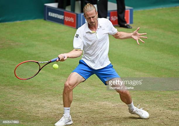 Peter Gojowczyk of Germany plays a forehand in his match against Alejandro Falla of Colombia during day five of the Gerry Weber Open at Gerry Weber...