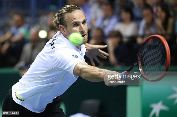 Peter Gojowczyk of Germany plays against Gael Monfils of France during the second round Davis Cup match between France and Germany at Palais des...