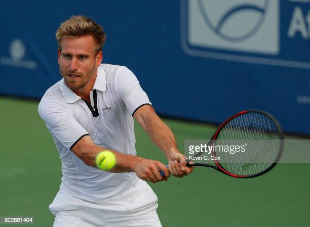Peter Gojowczyk of Germany returns a backhand to Guido Pella of Argentina during the BBT Atlanta Open at Atlantic Station on July 25 2017 in Atlanta...