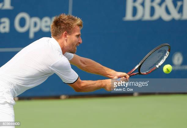 Peter Gojowczyk of Germany returns a backhand to Kyle Edmund of Great Britain during the BBT Atlanta Open at Atlantic Station on July 27 2017 in...