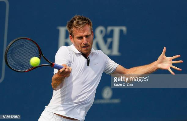 Peter Gojowczyk of Germany returns a forehand to Kyle Edmund of Great Britain during the BBT Atlanta Open at Atlantic Station on July 27 2017 in...