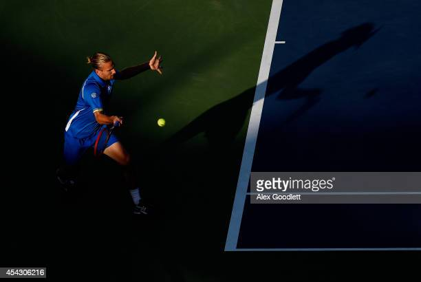 Peter Gojowczyk of Germany returns a shot against Milos Raonic of Canada on Day Four of the 2014 US Open at the USTA Billie Jean King National Tennis...