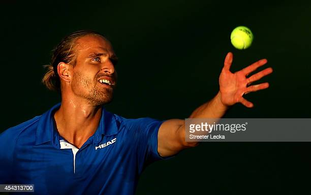 Peter Gojowczyk of Germany serves against Milos Raonic of Canada on Day Four of the 2014 US Open at the USTA Billie Jean King National Tennis Center...