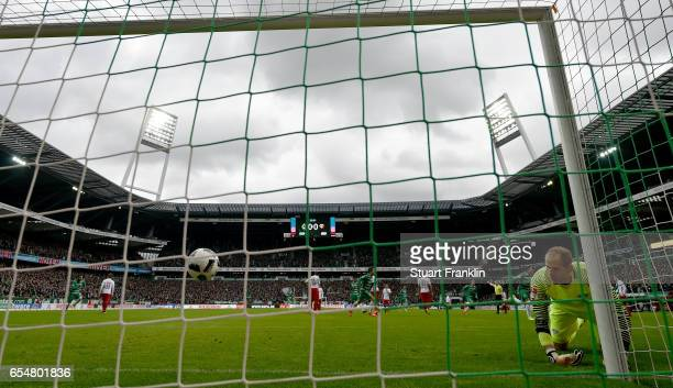 Peter Gulacsi of Leipzig looks to the ball after Zlatko Junuzovic of Bremen scored the first goal during the Bundesliga match between Werder Bremen...