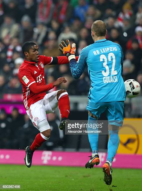 Peter Gulacsi of RB Leipzig fouls Douglas Costa of Bayern Muenchen and a penalty is awarded which is later score by Robert Lewandowski of Bayern...