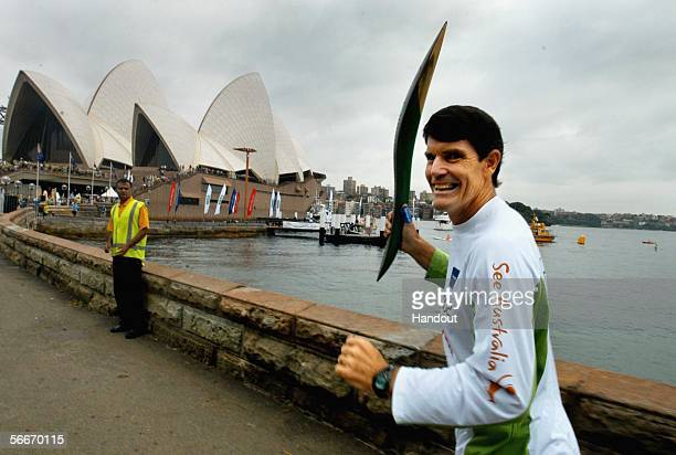 Peter Hadfield of Gymea parades the Melbourne 2006 Queen's Baton in front of Sydney Opera House crowdsThe Baton arrived in Australia on January 24...