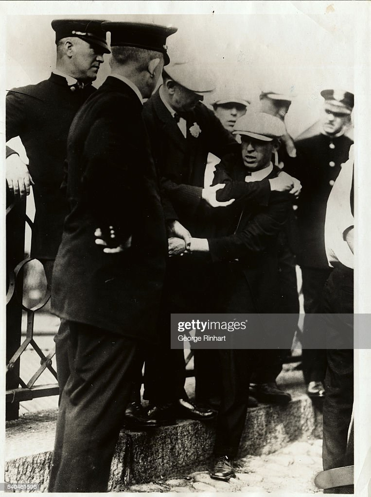 Peter Hagelias of Boston organizer for the Textile Mills Committee which called the strike at two mills here being arrested for leading the picket...