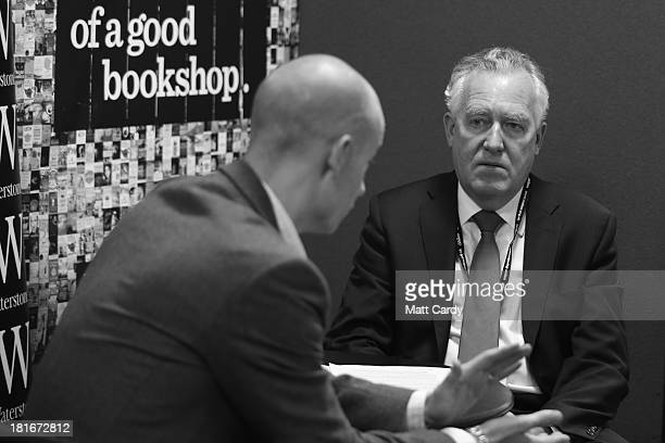 Peter Hain speaks at a book signing at the Labour Party conference on September 23 2013 in Brighton England The opposition Labour Party are holding...