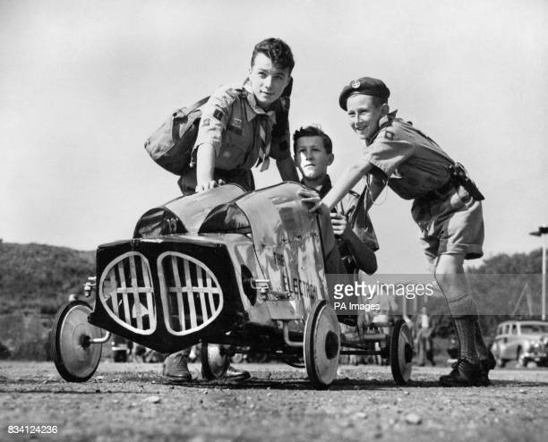 Peter Hambley at the wheel of 'The Electron' is pushed by Basil Mahon left and Alan Blundell The pedal driven cars are all made from scraps and cost...