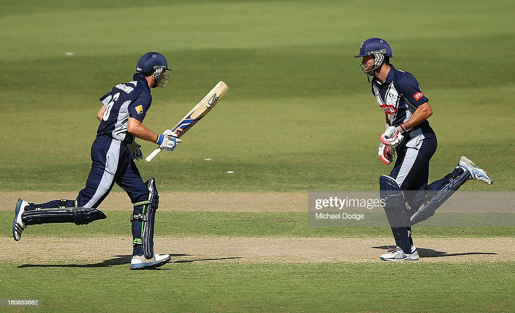 Peter Handscomb and Rob Quiney of Victoria run between wickets during the International tour match between the Victorian 2nd XI and the England Lions at Junction Oval on February 7, 2013 in Melbourne, Australia.