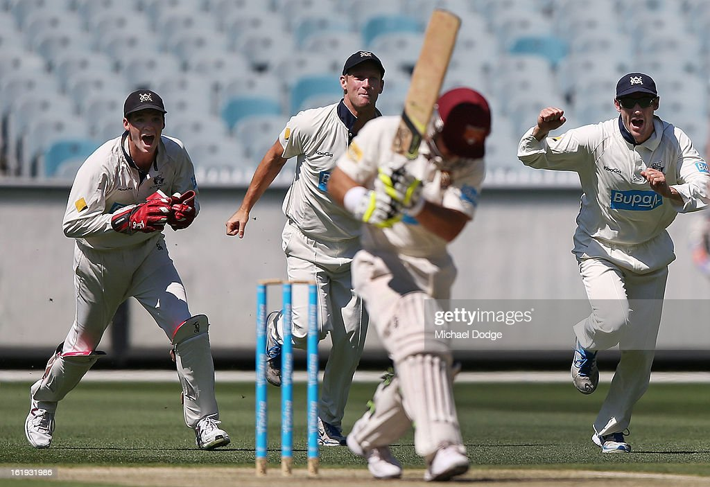 Peter Handscomb (L), Cameron White and David Hussey (R) celebrate the dismissal of Chris Hartley of the Queensland Bulls who got caught behind during day one of the Sheffield Shield match between the Victorian Bushrangers and the Queensland Bulls at Melbourne Cricket Ground on February 18, 2013 in Melbourne, Australia.
