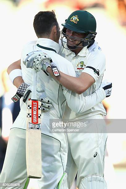 Peter Handscomb of Australia and Matthew Renshaw of Australia celebrate winning the match during day four of the Third Test match between Australia...