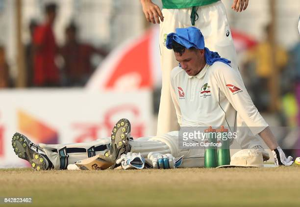 Peter Handscomb of Australia appears affected by the heat during day two of the Second Test match between Bangladesh and Australia at Zahur Ahmed...