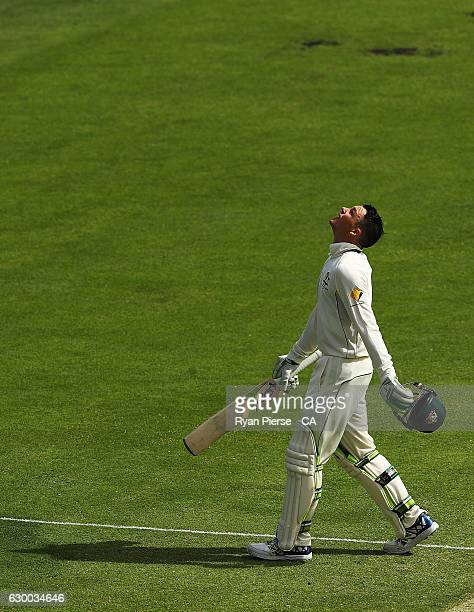 Peter Handscomb of Australia celebrates after reaching his maiden test century during day two of the First Test match between Australia and Pakistan...