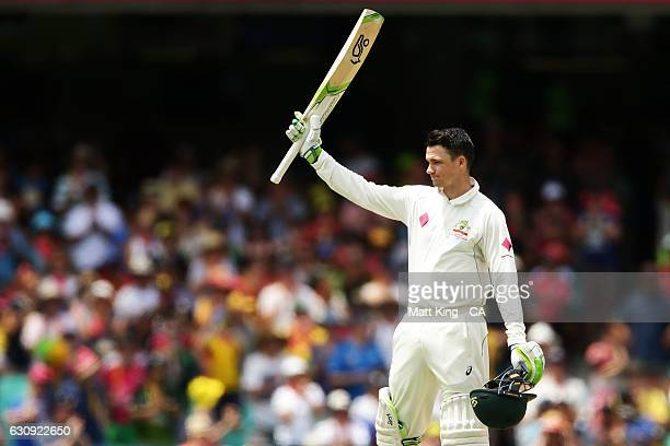 Peter Handscomb of Australia celebrates and acknowledges the crowd after scoring a century during day two of the Third Test match between Australia...