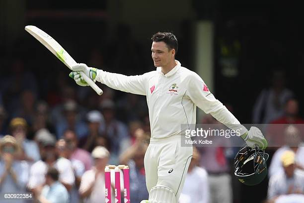 Peter Handscomb of Australia celebrates his century during day two of the Third Test match between Australia and Pakistan at Sydney Cricket Ground on...