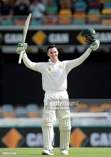 Peter Handscomb of Australia celebrates scoring a century during day two of the First Test match between Australia and Pakistan at The Gabba on...
