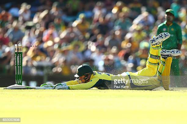 Peter Handscomb of Australia dives into the crease to avoid being run out during game three of the One Day International series between Australia and...