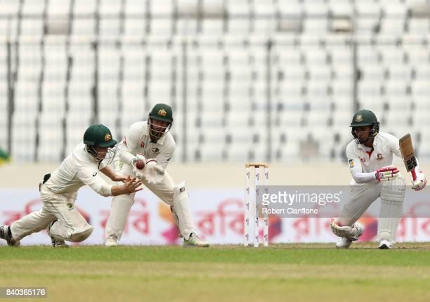 Peter Handscomb of Australia fields a shot from Mustafizur Rahman of Bangladesh during day three of the First Test match between Bangladesh and...