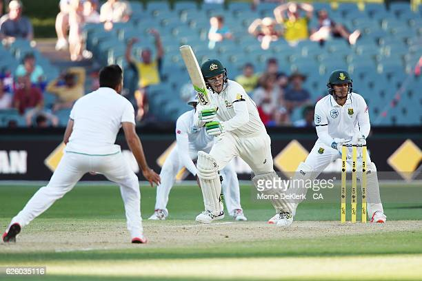 Peter Handscomb of Australia hits the winning run during day four of the Third Test match between Australia and South Africa at Adelaide Oval on...