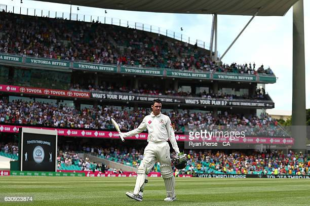 Peter Handscomb of Australia raises his bat after being dismissed for 110 runs during day two of the Third Test match between Australia and Pakistan...