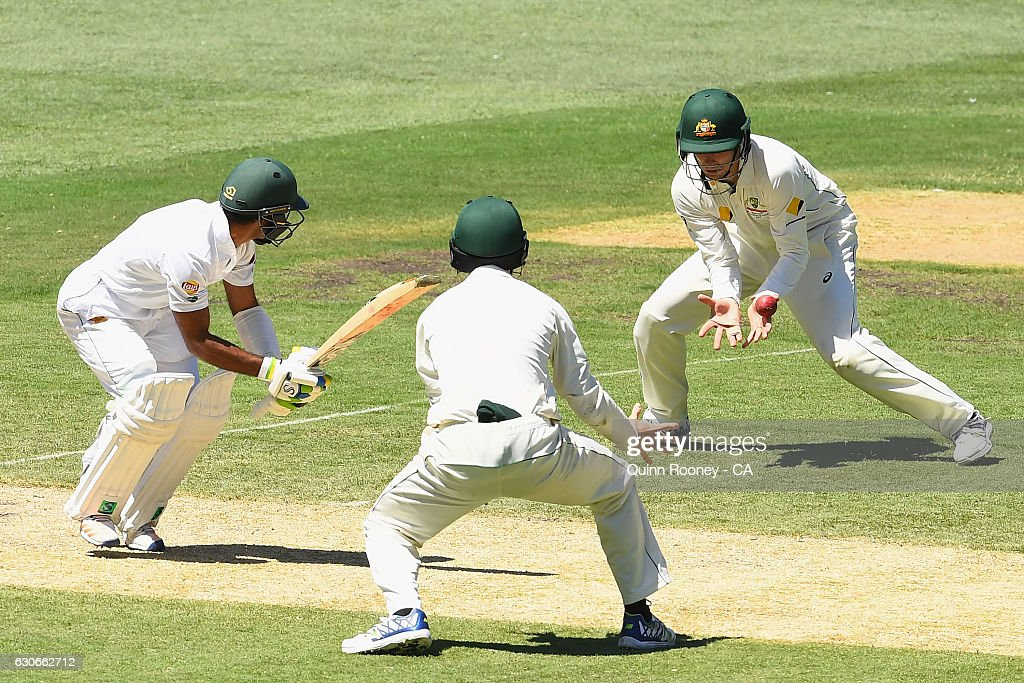 Peter Handscomb of Australia takes a catch to dismiss Asad Shafiq of Pakistan during day five of the Second Test match between Australia and Pakistan at Melbourne Cricket Ground on December 30, 2016 in Melbourne, Australia.