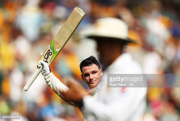 Peter Handscomb of Australia walks from the ground at tea on 103 not out after reaching his maiden test century during day two of the First Test...