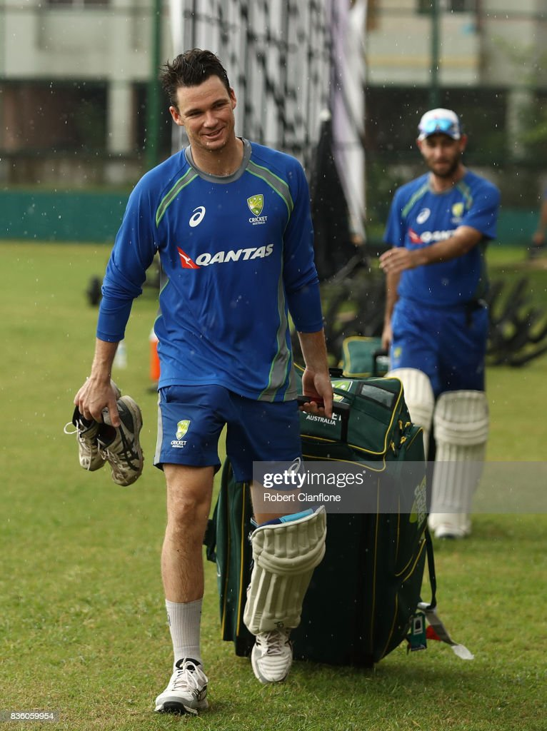 Peter Handscomb of Australia walks off the ground as rain falls during an Australian Test team nets session at Sher-E Bangla National Cricket Stadium on August 21, 2017 in Dhaka, Bangladesh.