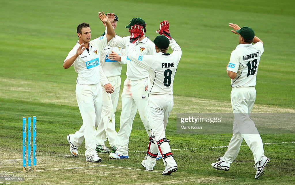 Peter Handscomb of Tasmania celebrates with team mates after bowling Evan Gulbis during day two of the Sheffield Shield match between the Tasmania Tigers and the Victoria Bushrangers at Blundstone Arena on March 15, 2013 in Hobart, Australia.