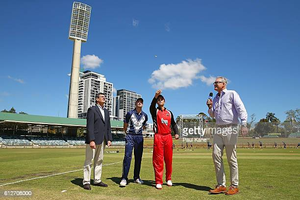 Peter Handscomb of the Bushrangers and Callum Ferguson of the Redbacks attend the coin toss with match referee Steve Bernard and commentator Tom...