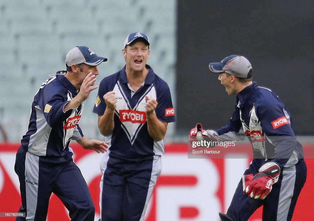 Peter Handscomb (R) of the Bushrangers celebrates with David Hussey and Cameron White after taking a catch to dismiss Greg Moller of the Bulls during the Ryobi One Day Cup final match between the Victorian Bushrangers and the Queensland Bulls at Melbourne Cricket Ground on February 27, 2013 in Melbourne, Australia.