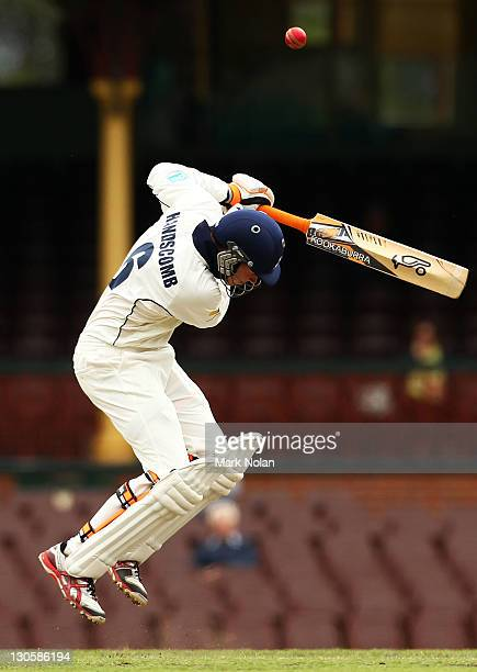 Peter Handscomb of the Bushrangers is hit by a delivery from Sean Abbott of the Blues during day three of the Shieffield Shield match between the New...