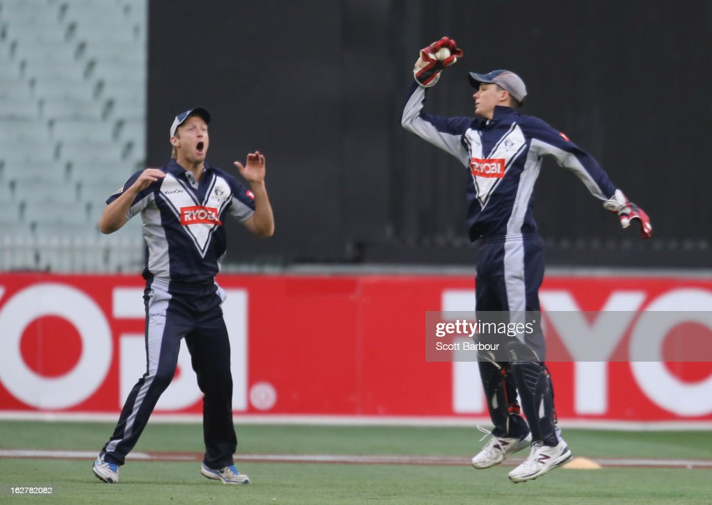 Peter Handscomb (R) of the Bushrangers takes a catch to dismiss Greg Moller of the Bulls as Cameron White looks on during the Ryobi One Day Cup final match between the Victorian Bushrangers and the Queensland Bulls at Melbourne Cricket Ground on February 27, 2013 in Melbourne, Australia.