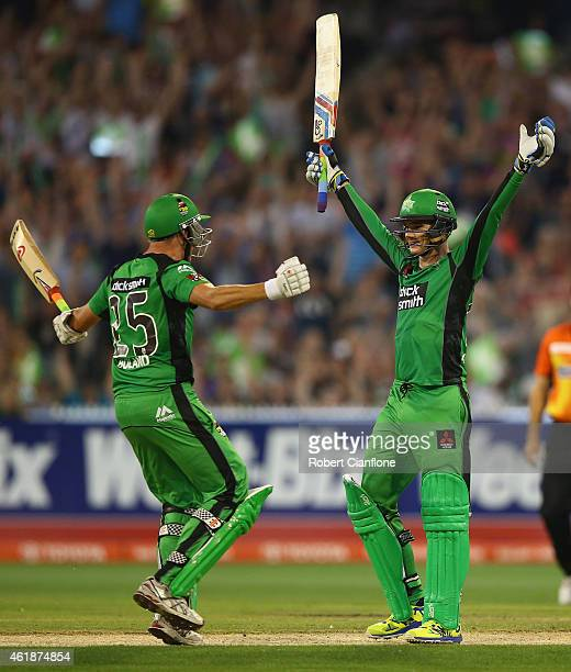 Peter Handscomb of the Melbourne Stars celebrates with team mate Scott Boland after scoring the winning runs and a century during the Big Bash League...