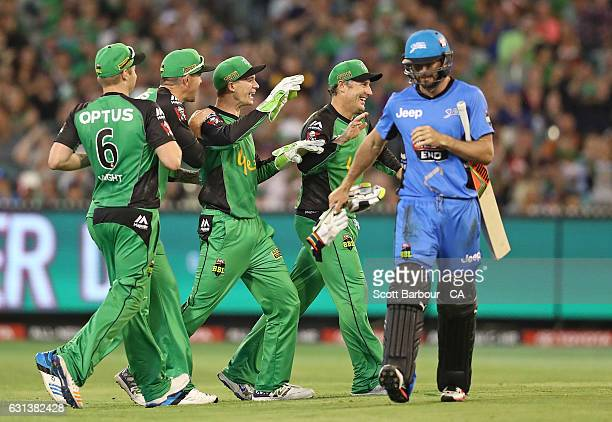 Peter Handscomb of the Stars is congratulated by his teammates after running out Michael Neser of the Strikers during the Big Bash League match...