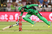 Peter Handscomb of the Stars slides in to avoid a runout during the Big Bash League match between the Sydney Thunder and the Melbourne Stars at...