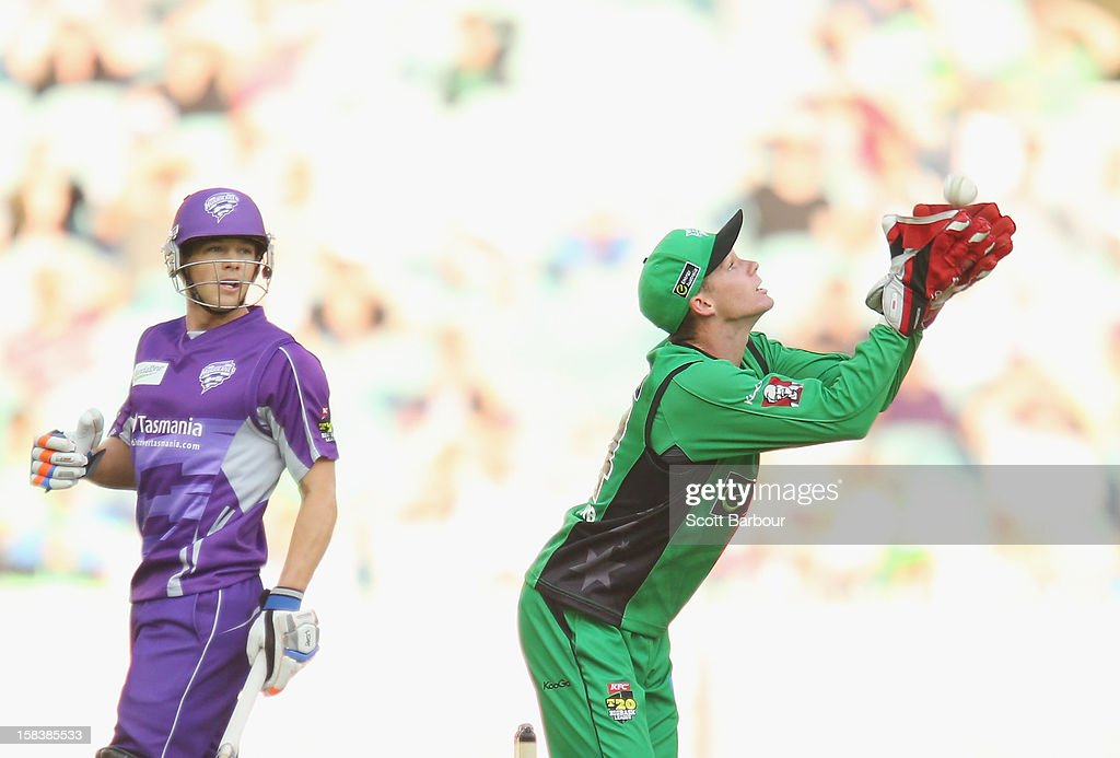 Peter Handscomb of the Stars takes a catch to dismiss Travis Birt of the Hurricanes during the Big Bash League match between the Melbourne Stars and the Hobart Hurricanes at the Melbourne Cricket Ground on December 15, 2012 in Melbourne, Australia.