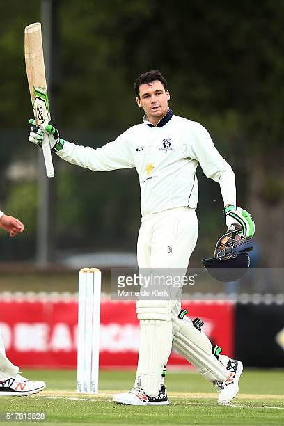 Peter Handscomb of the VIC Bushrangers celebrates reaching 100 runs during day 3 of the Sheffield Shield Final match between South Australia and...
