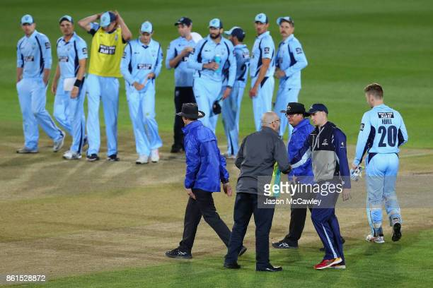 Peter Handscomb of Victoria shakes match referees Daryl Harper's hand during the JLT One Day Cup match between New South Wales and Victoria at North...
