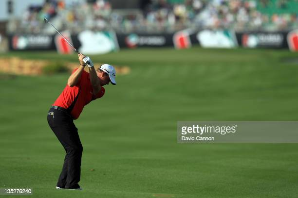 Peter Hanson of Sweden plays his second shot at the par 5 18th hole during the first round of the Dubai World Championship on the Earth Course at the...