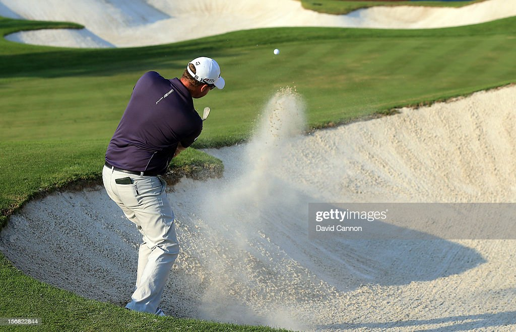 Peter Hanson of Sweden plays his second shot on the par four 15th hole during the first round of the 2012 DP World Tour Championship on the Earth Course at Jumeirah Golf Estates on November 22, 2012 in Dubai, United Arab Emirates.