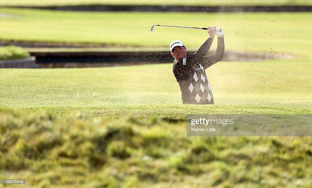 Peter Hanson of Sweden plays his second shot to the 18th hole during the first round of The Alfred Dunhill Links Championship at Carnoustie Golf Links on October 4, 2012 in Carnoustie, Scotland.