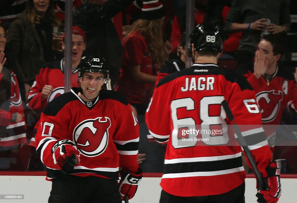Peter Harrold of the New Jersey Devils celebrates his goal at 1518 of the first period against the Detroit Red Wings along with Jaromir Jagr at the...