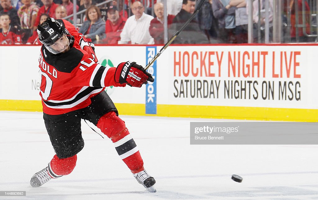 Peter Harrold of the New Jersey Devils controls the puck against the New York Rangers in Game Three of the Eastern Conference Final during the 2012...
