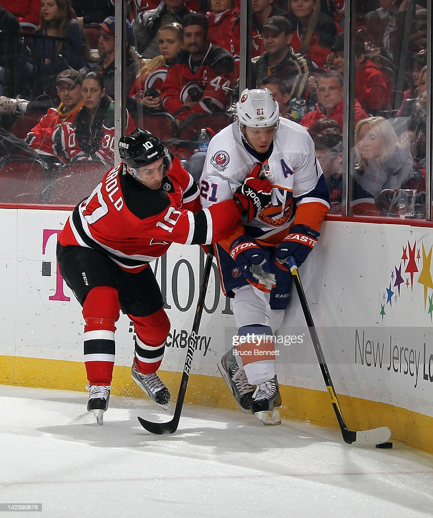 <a gi-track='captionPersonalityLinkClicked' href=/galleries/search?phrase=Peter+Harrold&family=editorial&specificpeople=579399 ng-click='$event.stopPropagation()'>Peter Harrold</a> #10 of the New Jersey Devils holds on to <a gi-track='captionPersonalityLinkClicked' href=/galleries/search?phrase=Kyle+Okposo&family=editorial&specificpeople=540469 ng-click='$event.stopPropagation()'>Kyle Okposo</a> #21 of the New York Islanders at the Prudential Center on April 3, 2012 in Newark, New Jersey. The Devils defeated the Islanders 3-1.