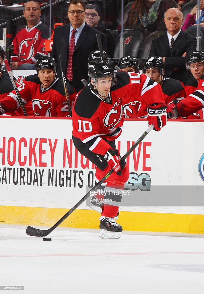 Peter Harrold of the New Jersey Devils plays the puck against the Florida Panthers at the Prudential Center on January 31 2015 in Newark New Jersey
