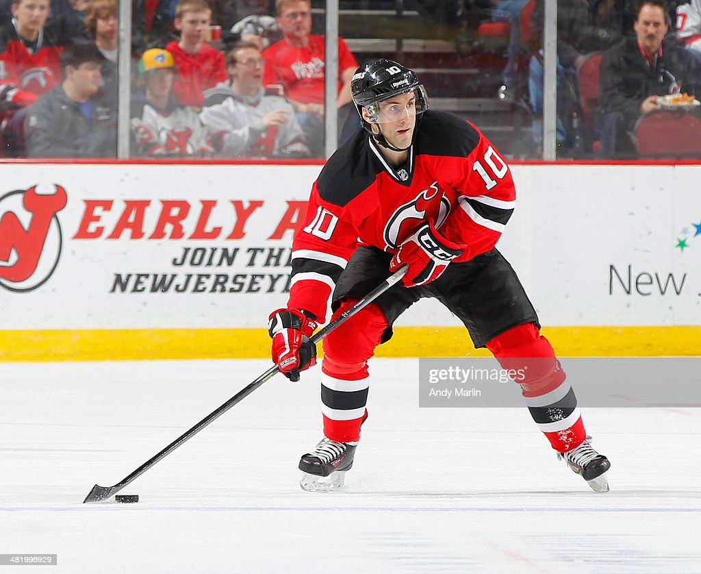 Peter Harrold of the New Jersey Devils plays the puck against the Phoenix Coyotes during the game at the Prudential Center on March 27 2014 in Newark...